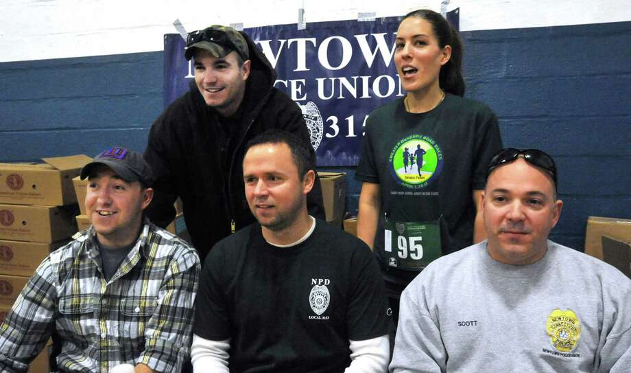 Members of the Newtown Police Union were at the Stratton Faxon Greater Danbury Half Marathon and 5K race in Danbury, Conn. Sunday, April 7, 2013. They raised funds for the War Memorial and Newtown First Responders. Photo: Michael Duffy / The News-Times