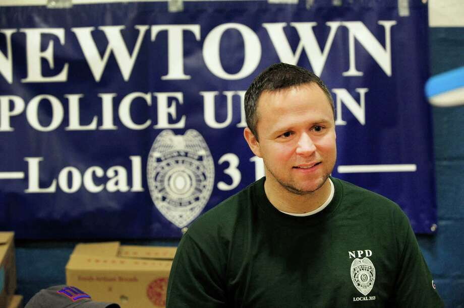 Daniel McAnaspie, of the Newtown Police Union, was at the Stratton Faxon Greater Danbury Half Marathon and 5K race in Danbury, Conn. Sunday, April 7, 2013. He and other union members raised funds for the War Memorial and Newtown First Responders. Photo: Michael Duffy / The News-Times