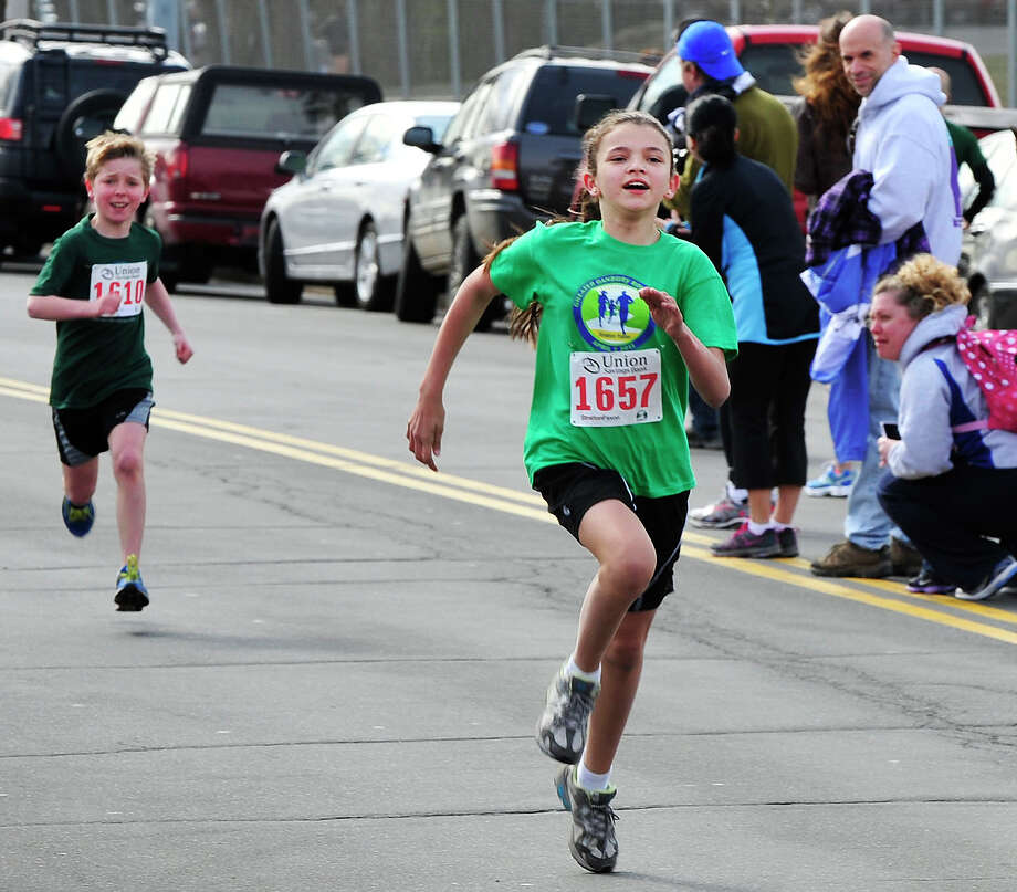 Katalina Baehing, 11, of Hamden wins the Union Saving Bank Kids Run during the Stratton Faxon Greater Danbury Half Marathon and 5K race in Danbury, Conn. Sunday, April 7, 2013. Photo: Michael Duffy / The News-Times