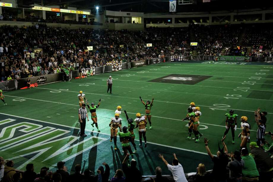 Following a home team touchdown, Seattle Mist players rejoice during a lingerie football game Saturday, April 6, 2013, at the ShoWare Center in Kent. Photo: JORDAN STEAD / SEATTLEPI.COM