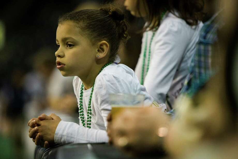 A girl watches Seattle Mist players warm up before a lingerie football game against the Green Bay Chill Saturday, April 6, 2013, at the ShoWare Center in Kent. Photo: JORDAN STEAD / SEATTLEPI.COM