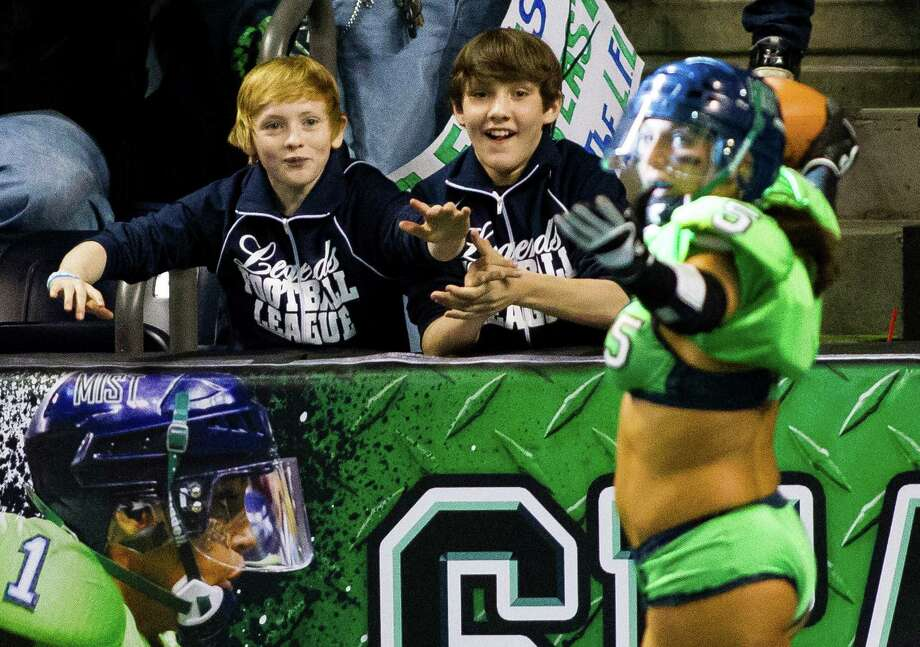 Young boys eagerly celebrate a Seattle Mist touchdown during a lingerie football game Saturday, April 6, 2013, at the ShoWare Center in Kent. Photo: JORDAN STEAD / SEATTLEPI.COM