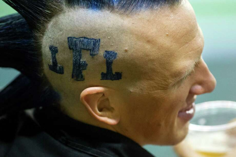 A fan sports the LFL insignia on his head during a Seattle Mist lingerie football game Saturday, April 6, 2013, at the ShoWare Center in Kent. Photo: JORDAN STEAD / SEATTLEPI.COM