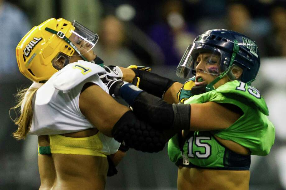 The Seattle Mist's Shea Norton, right, tangles with a Green Bay Chill player during a lingerie football game Saturday, April 6, 2013, at the ShoWare Center in Kent. Photo: JORDAN STEAD / SEATTLEPI.COM