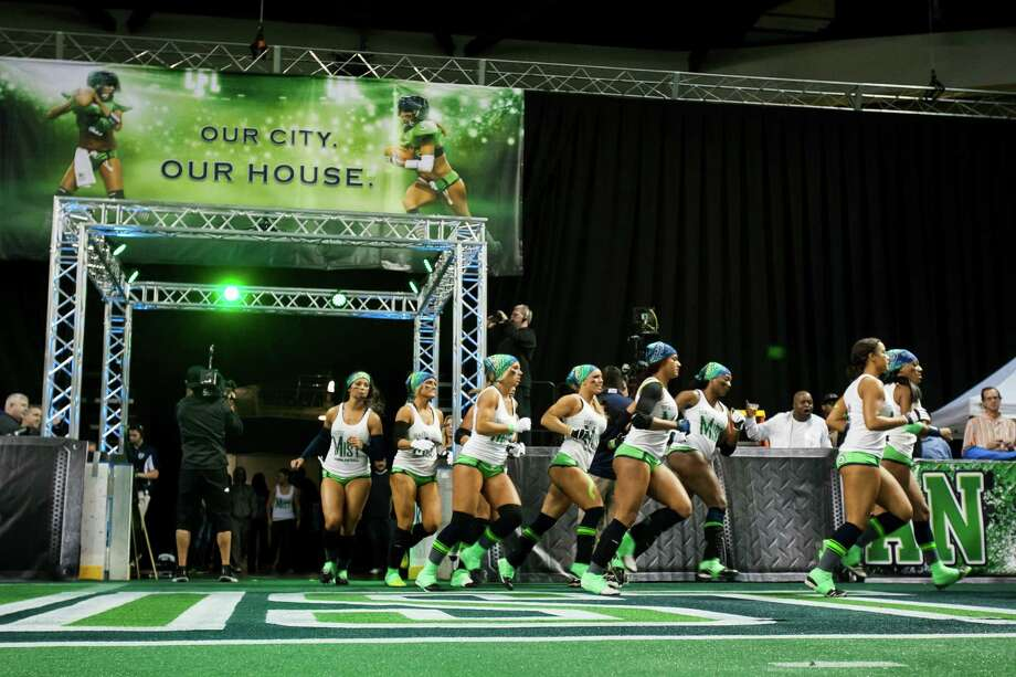 Seattle Mist players take to the field for warm up before a lingerie football game against the Green Bay Chill Saturday, April 6, 2013, at the ShoWare Center in Kent. Photo: JORDAN STEAD / SEATTLEPI.COM