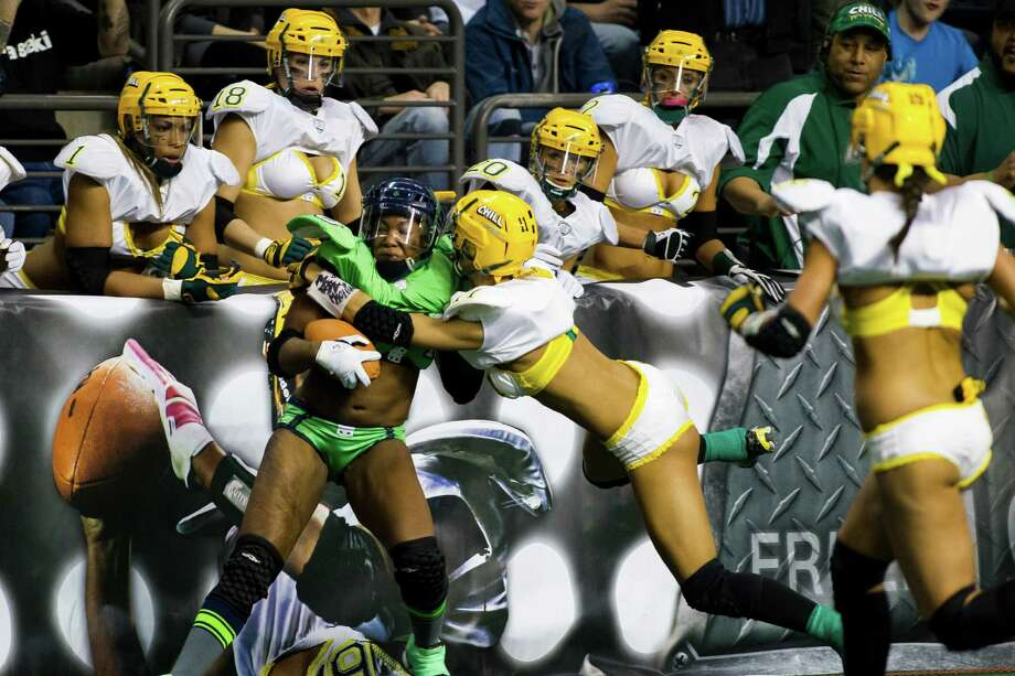 Players clash against the sidelines near the end zone during a lingerie football game Saturday, April 6, 2013, at the ShoWare Center in Kent. Photo: JORDAN STEAD / SEATTLEPI.COM