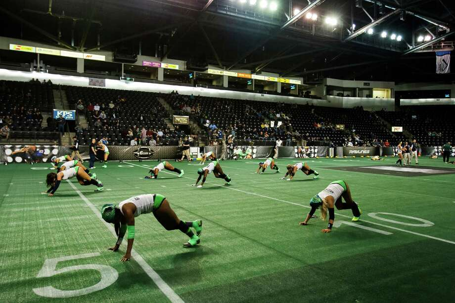 Seattle Mist players warm up before a lingerie football game against the Green Bay Chill Saturday, April 6, 2013, at the ShoWare Center in Kent. Photo: JORDAN STEAD / SEATTLEPI.COM