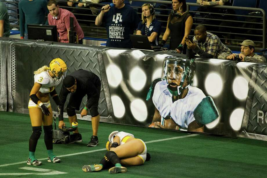 A Green Bay Chill player is examined for injury during a lingerie football game against the Seattle Mist Saturday, April 6, 2013, at the ShoWare Center in Kent. Photo: JORDAN STEAD / SEATTLEPI.COM