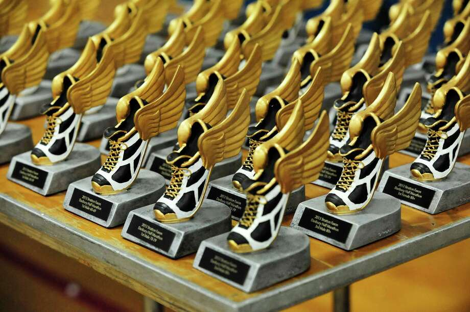 Runners trophys await the finishers in the Stratton Faxon Greater Danbury Half Marathon and 5K race in Danbury, Conn. Sunday, April 7, 2013. Photo: Michael Duffy / The News-Times