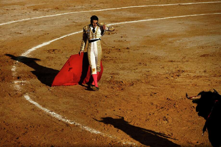 Spain's bullfighter Juan Jose Padilla performs with a Garcigrande ranch fighting bull during a bullfight in La Muralla bullring in Brihuega, Spain, Saturday, April 6, 2013. Bullfighting is an ancient tradition in Spain and the season runs from March to October. Photo: AP