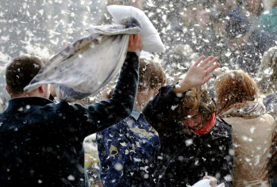 In this picture made available Sunday April 7, 2013 young people participate in a pillow fight to mark the International Pillow Fight Day in Budapest, Hungary, Saturday, April  6, 2013. Photo: AP