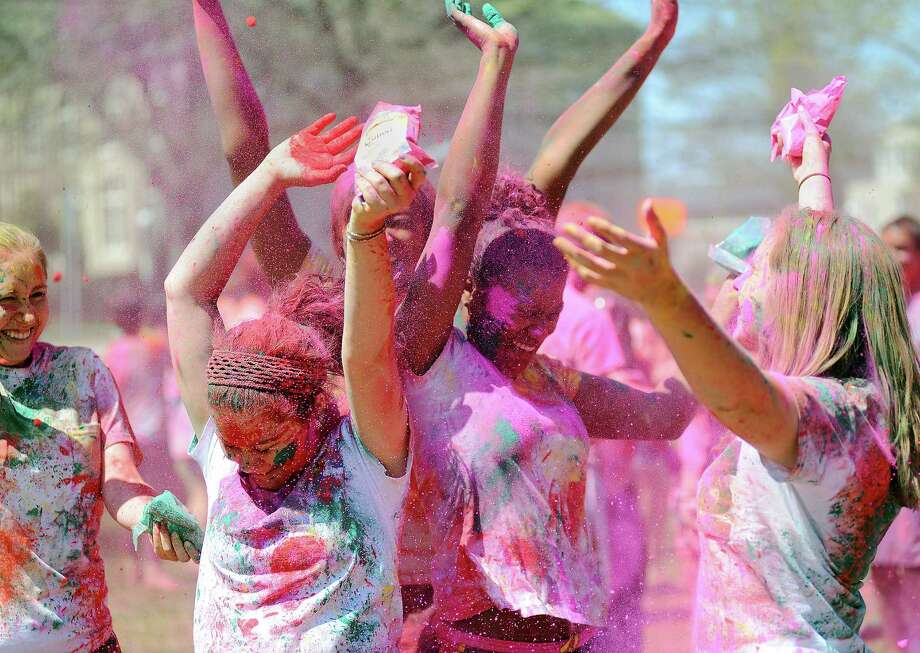 Duke students celebrate Holi on the East campus in Durham, NC Saturday, April 6, 2013. Holi is a Hindu celebration to welcome the arrival of Spring, during which people are throwing colored powder on each other. traditionally, people wear white when celebrating Holi so that the colors of festival are visible. Photo: AP