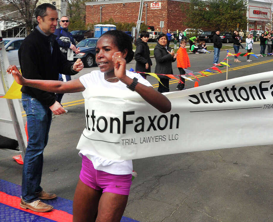 Shtaye Bekele, of Ethiopia, wins the Half Marathon in the Stratton Faxon Greater Danbury Half Marathon and 5K race in Danbury, Conn. Sunday, April 7, 2013. Photo: Michael Duffy / The News-Times