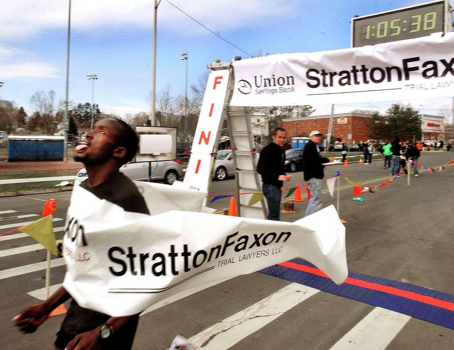 Amos Sang, of Kenya, wins the Half Marathon in the Stratton Faxon Greater Danbury Half Marathon and 5K race in Danbury, Conn. Sunday, April 7, 2013. His time was one hour, five minutes and 38 seconds. Photo: Michael Duffy / The News-Times
