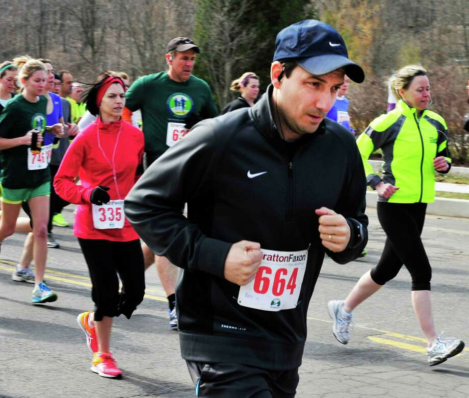 Runners begin theHalf Marathon during the Stratton Faxon Greater Danbury Half Marathon and 5K race in Danbury, Conn. Sunday, April 7, 2013. Photo: Michael Duffy / The News-Times