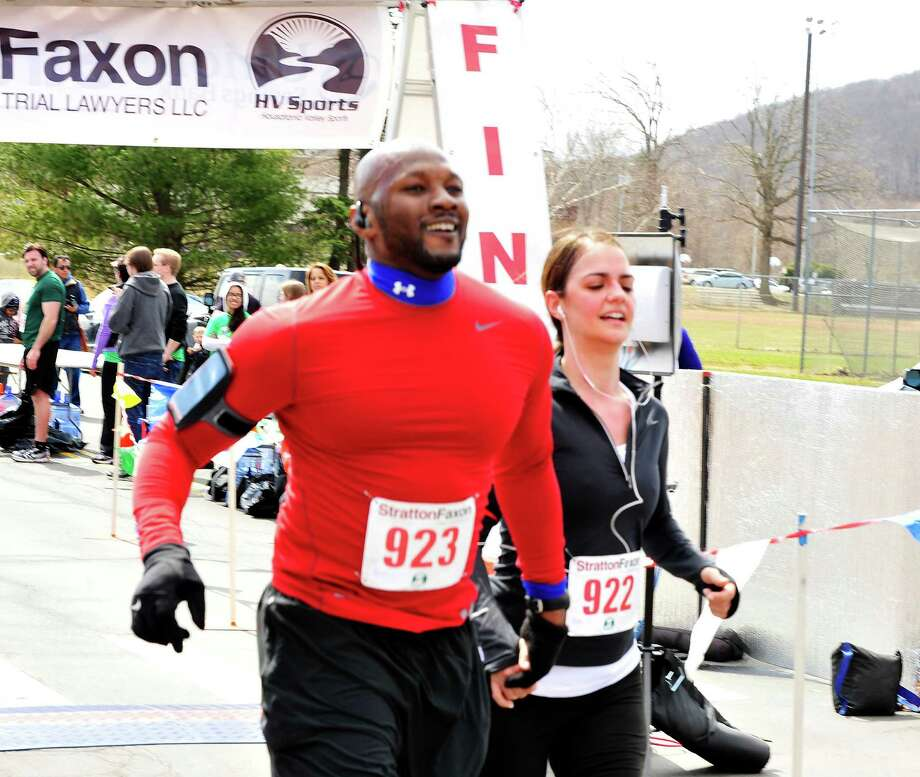 Runners finish the 5K race during the Stratton Faxon Greater Danbury Half Marathon and 5K race in Danbury, Conn. Sunday, April 7, 2013. Photo: Michael Duffy / The News-Times