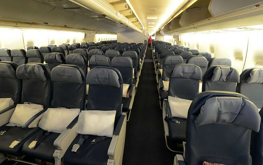 Economy seating is shown on a Delta Airlines 747 at Maynard H. Jackson International Terminal on March 20, 2013. Airlines are investing in the creature comforts for first and business class seats as the company seeks to up sell to those passengers sitting in coach. (Kent D. Johnson/Atlanta Journal-Constitution/MCT) Photo: Kent D. Johnson, McClatchy-Tribune News Service