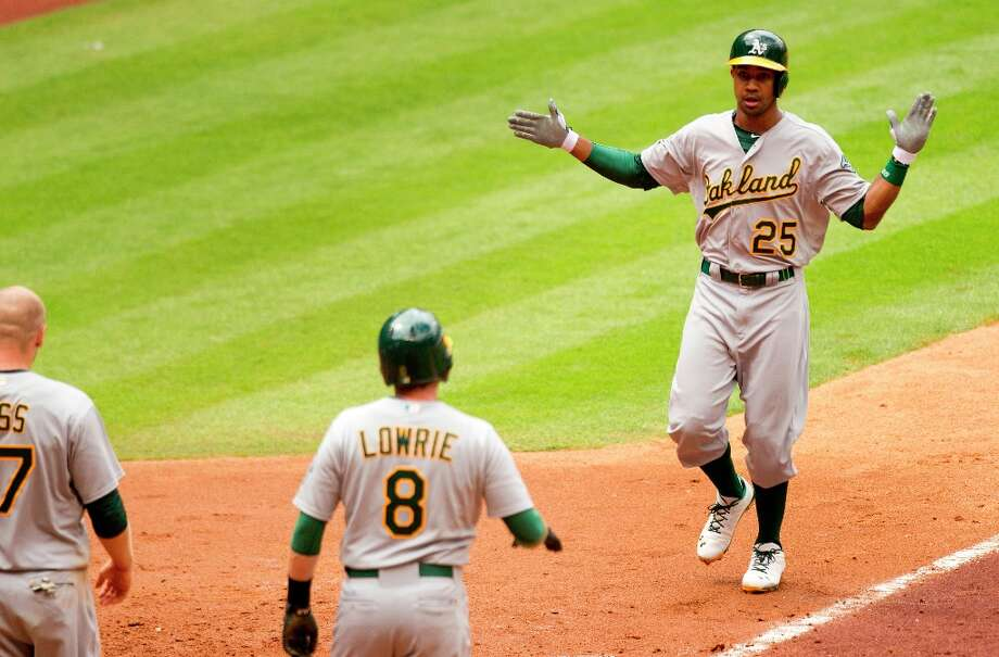 Athletics outfielder Chris Young (25) celebrates his three-run home run during the fifth inning off Astros starting pitcher Lucas Harrell. Photo: Brett Coomer, Chronicle / © 2013 Houston Chronicle