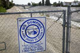 A warning against dumping at a drainage canal in Culver City, Calif., April 5, 2013. Los Angeles County is home to seven of the ten most polluted beaches in California, largely due to rainwater runoff from the city, and a proposed property fee to pay for capturing storm water has stalled among loud objections. (Monica Almeida/The New York Times)
