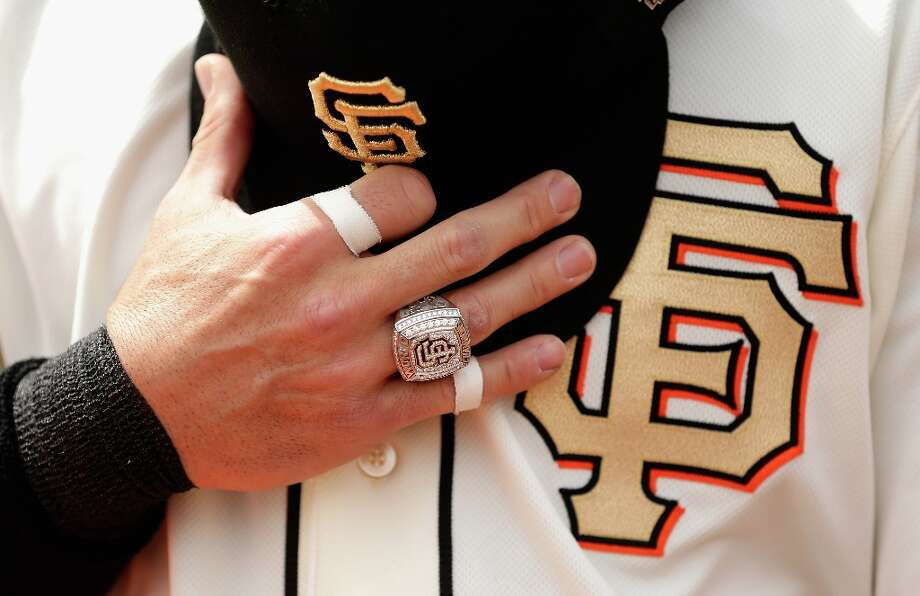 Marco Scutaro #19 of the San Francisco Giants wears his 2012 Championship Ring and holds his hat during the playing of the National Anthem before their game against the St. Louis Cardinals at AT&T Park on April 7, 2013 in San Francisco, California.  The Giants were given their Championship rings during a ceremony before the start of their game. Photo: Ezra Shaw, Getty Images / 2013 Getty Images