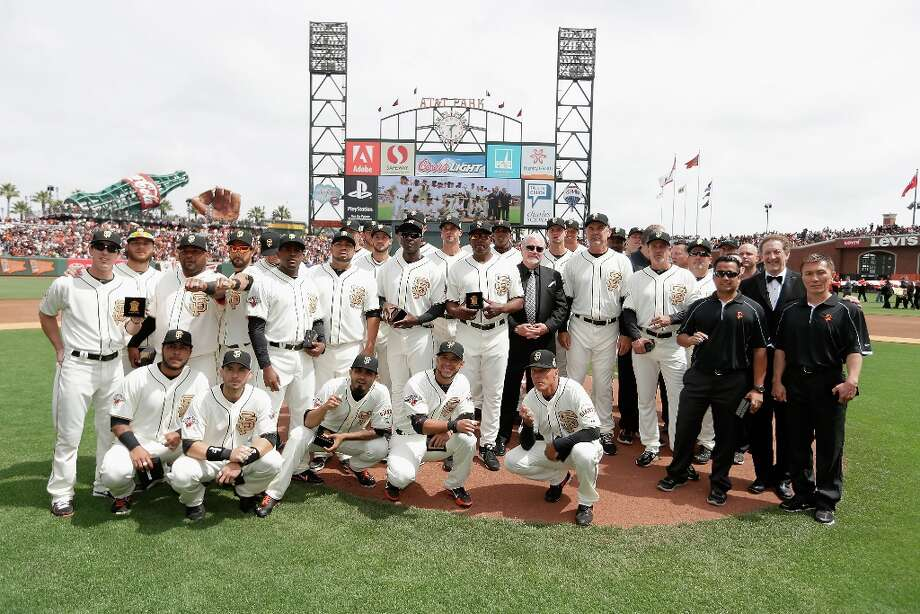 The 2012 World Series champion San Francisco Giants pose for a team photo after receiving their Championship Rings during a pregame ceremony before their game against the St. Louis Cardinals at AT&T Park on April 7, 2013 in San Francisco, California. Photo: Ezra Shaw, Getty Images / 2013 Getty Images