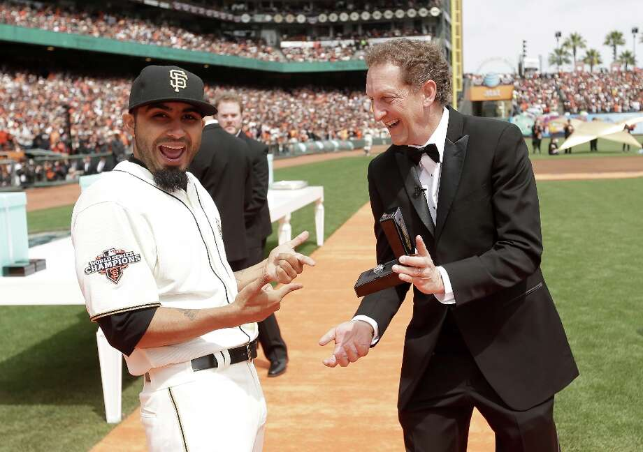 San Francisco Giants President and Chief Executive Officer Larry Baer gives Sergio Romo #54 his 2012 Championship Ring during a pregame ceremony honoring the 2012 World Series champions before their game against the St. Louis Cardinals at AT&T Park on April 7, 2013 in San Francisco, California. Photo: Ezra Shaw, Getty Images / 2013 Getty Images
