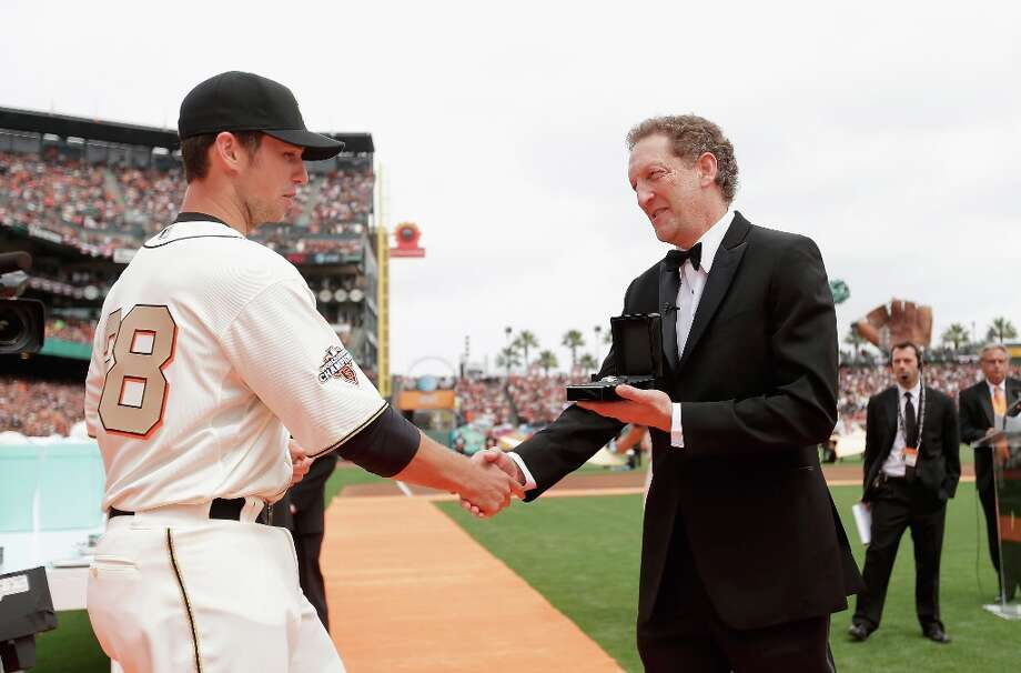 San Francisco Giants President and Chief Executive Officer Larry Baer gives Buster Posey #28 his 2012 Championship Ring during a pregame ceremony honoring the 2012 World Series champions before their game against the St. Louis Cardinals at AT&T Park on April 7, 2013 in San Francisco, California. Photo: Ezra Shaw, Getty Images / 2013 Getty Images