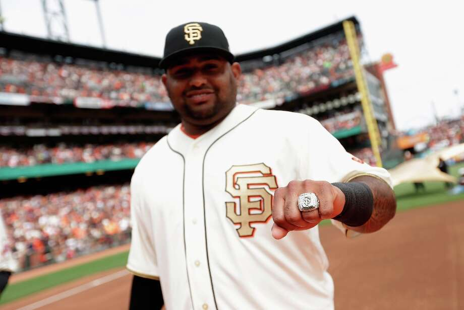 Pablo Sandoval #48 of the San Francisco Giants shows off his 2012 Championship ring before their game against the St. Louis Cardinals at AT&T Park on April 7, 2013 in San Francisco, California.  The Giants were given their Championship rings during a ceremony honoring the 2012 World Series champions before the start of their game. Photo: Ezra Shaw, Getty Images / 2013 Getty Images
