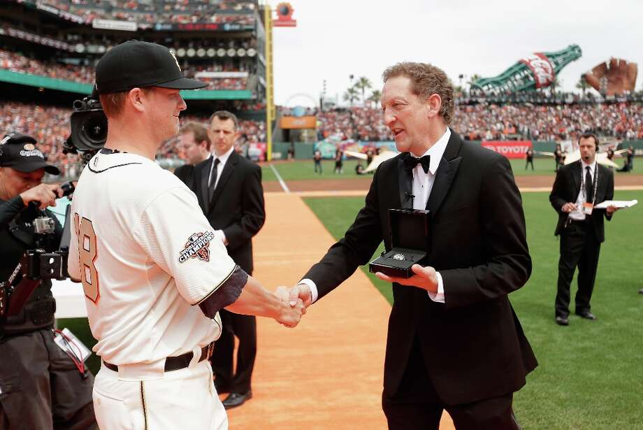 San Francisco Giants President and Chief Executive Officer Larry Baer gives Matt Cain #18 his 2012 Championship Ring during a pregame ceremony honoring the 2012 World Series champions before their game against the St. Louis Cardinals at AT&T Park on April 7, 2013 in San Francisco, California. Photo: Ezra Shaw, Getty Images / 2013 Getty Images