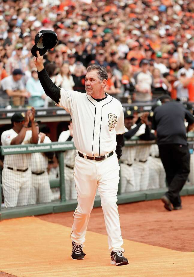 Manager Bruce Bochy #15 of the San Francisco Giants  waves to the crowd as he walks on to the field to receive his 2012 Championship Ring during a pregame ceremony honoring the 2012 World Series champions before their game against the St. Louis Cardinals at AT&T Park on April 7, 2013 in San Francisco, California. Photo: Ezra Shaw, Getty Images / 2013 Getty Images