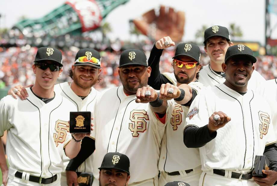 Players of the San Francisco Giants show off their 2012 Championship rings before their game against the St. Louis Cardinals at AT&T Park on April 7, 2013 in San Francisco, California.  The Giants were given their Championship rings during a ceremony honoring the 2012 World Series champions before the start of their game. Photo: Ezra Shaw, Getty Images / 2013 Getty Images