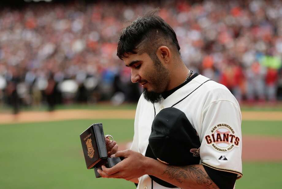 SAN FRANCISCO, CA - APRIL 07:  Sergio Romo #54 of the San Francisco Giants looks at his 2012 Championship Ring during a pregame ceremony honoring the 2012 World Series champions before their game against the St. Louis Cardinals at AT&T Park on April 7, 2013 in San Francisco, California. Photo: Ezra Shaw, Getty Images / 2013 Getty Images