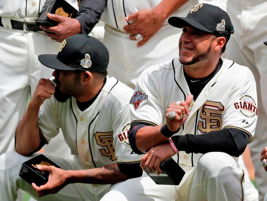 San Francisco Giants relief pitcher Sergio Romo, left, and outfielder Gregor Blanco display their 2012 World Series championship rings before a baseball game against the St. Louis Cardinals, Sunday, April 7, 2013, in San Francisco. (AP Photo/Marcio Jose Sanchez) Photo: Marcio Jose Sanchez, Associated Press / AP