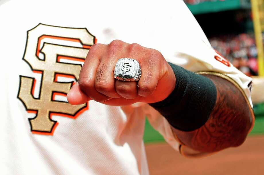 San Francisco Giants third baseman Pablo Sandoval shows his 2012 World Series championship ring before a baseball game against the St. Louis Cardinals, Sunday, April 7, 2013, in San Francisco. (AP Photo/Ezra Shaw, Pool) Photo: Ezra Shaw, Associated Press / PooL Getty
