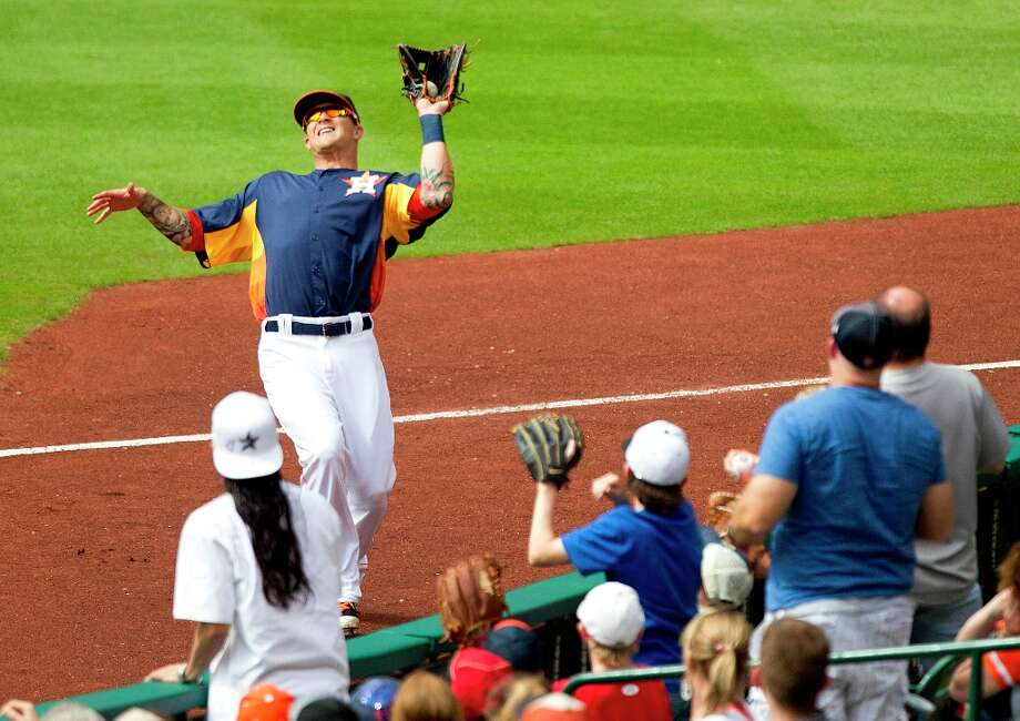 Astros right fielder Brandon Barnes makes a catch on a ball hit by Athletics designated hitter Coco Crisp in foul territory during the eighth inning. Photo: Brett Coomer / © 2013 Houston Chronicle