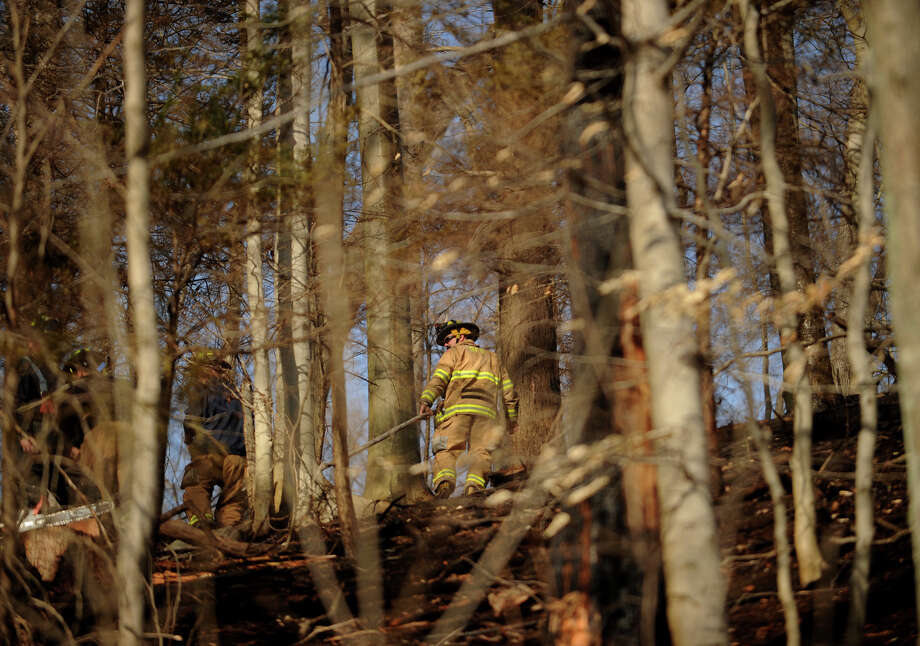 Valley area firefighters put down the final remnants of a ten acre brush fire off Roosevelt Drive in Derby, Conn. on Sunday, April 7, 2013. Photo: Brian A. Pounds / Connecticut Post