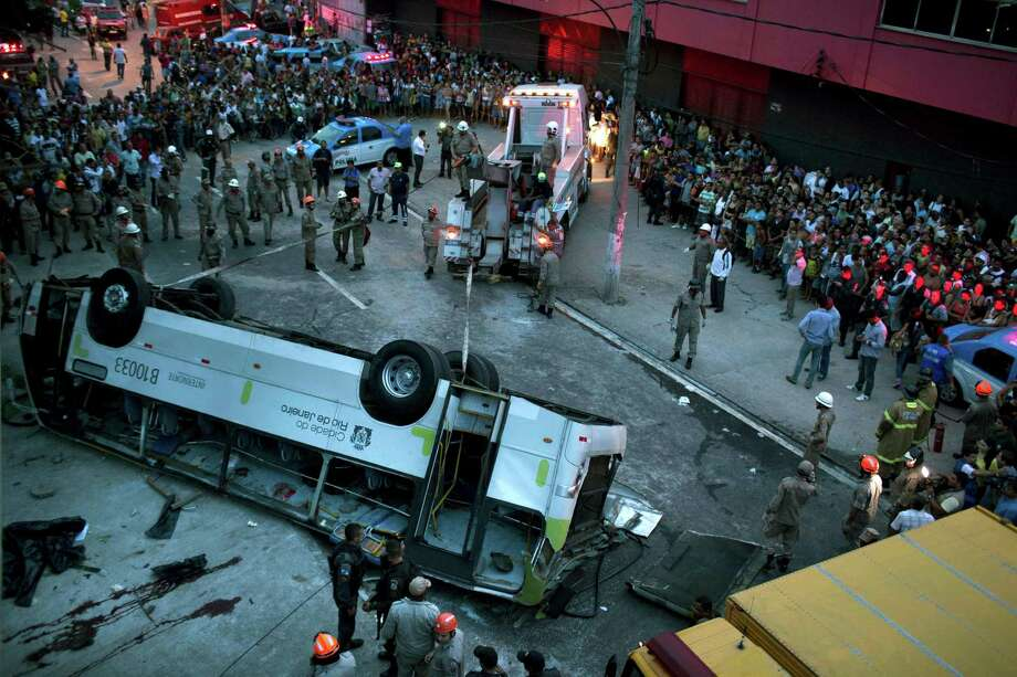 A bus is seen upside down after falling from a viaduct into Avenida Brasil, the largest avenue in Rio de Janeiro, Brazil, Tuesday, April 2, 2013. A passenger bus plunged from a 10-meter-high (30-foot) viaduct in central Rio de Janeiro killing at least seven people and closing a major thoroughfare. Photo: AP