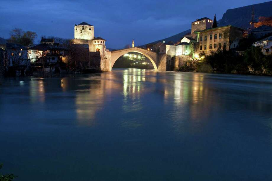 Long time exposure photograp shows the Old Bridge located in the center of the Old City of Mostar, during floods of Neretva river, in the southern Bosnian town of Mostar, 140 kms south of Sarajevo, on Wednesday, April 3, 2013. The �Old Bridge� was built in 1566, destroyed during the Bosnian war 1992-1995 and rebuilt and reopened for use in 2004. Water levels are around 3m (10 feet ) higher that usual having dramatically risen countrywide, due to snow-melt and large quantities of rain in past 7 days. Photo: AP