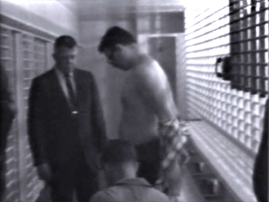 This image from video released Tuesday April 2, 2013 on the 45th anniversary of Martin Luther King Jr.'s death shows James Earl Ray being searched at the Memphis jail in 1968. Officials in Tennessee unearthed the tapes of Ray in 2011 but had no way to view the old technology. The tapes have been converted to a viewable format and were released Tuesday April 2, 2013. Photo: AP