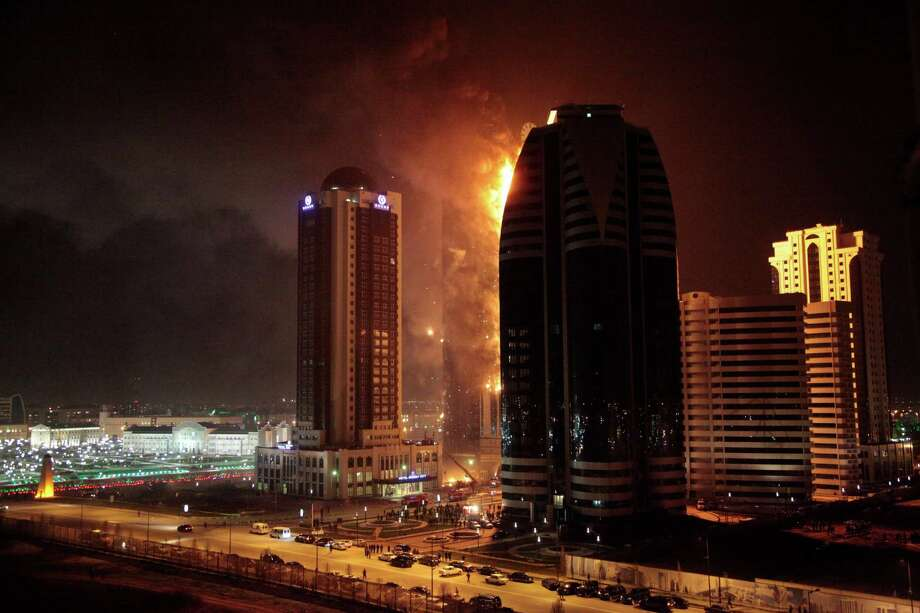 In this photo taken on Wednesday, April 3, 2013, a fire rages in a high-rise apartment building in provincial capital Grozny, Russia. The fire  engulfed the unoccupied 40-storey apartment building under construction in Chechnya, a once war-torn republic in southern Russia. Emergency officials say 30 people fled the flames on Wednesday, but no one was injured. The cause of the fire has not yet been determined. Photo: AP