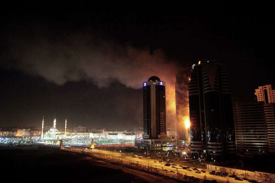 In this photo taken on Wednesday, April 3, 2013, a fire rages in a high-rise apartment building in provincial capital Grozny, Russia.The fire  engulfed the unoccupied 40-storey apartment building under construction in Chechnya, a once war-torn republic in southern Russia. Emergency officials say 30 people fled the flames on Wednesday, but no one was injured. The cause of the fire has not yet been determined. Photo: AP