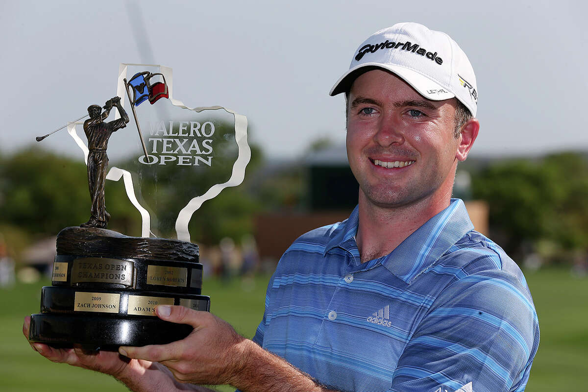Martin Laird, of Glasgow, Scotland holds the 2013 Valero Texas Open trophey after winning the tournament, Sunday, April 7, 2013. Laird came from five strokes behind to finish at 14-under-par and took home $1,116,000.