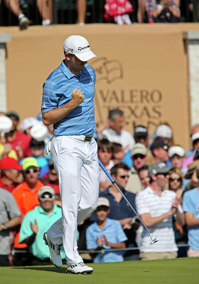 Martin Laird, of Glasgow, Scotland pumps his fist after sinking a birdie on the 18th green to takes the 2013 Valero Texas Open, Sunday, April 7, 2013. Laird started the day at five strokes behind Billy Horschel but his birdied the last three holes to seal the win. Photo: Jerry Lara, Express-News / ©2013 San Antonio Express-News