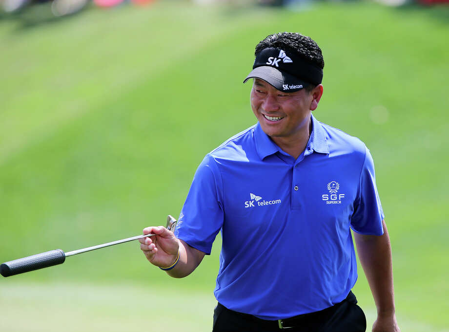K.J. Choi smiles after saving par on the 15th green of the final day at the 2013 Valero Texas Open, Sunday, April 7, 2013. Choi ended the day at 9-under-par and in sixth place. Photo: Jerry Lara, Express-News / ©2013 San Antonio Express-News
