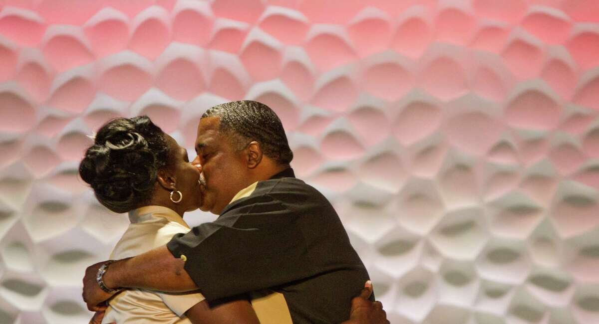 Wanda Ware kisses her new husband Bryan Prejean, during their wedding, Sunday, April 7, 2013, in Houston. The couple were once homeless and attended bible class at the church. Community members donated make up, food and a cake for the wedding.