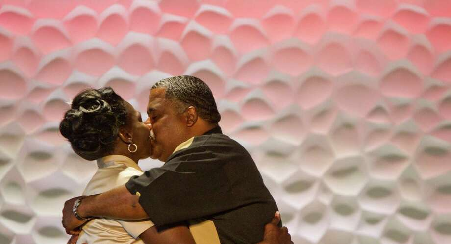 Wanda Ware kisses her new husband Bryan Prejean, during their wedding, Sunday, April 7, 2013, in Houston. The couple were once homeless and attended bible class at the church. Community members donated make up, food and a cake for the wedding. Photo: Nick De La Torre, Chronicle / © 2013 Houston Chronicle