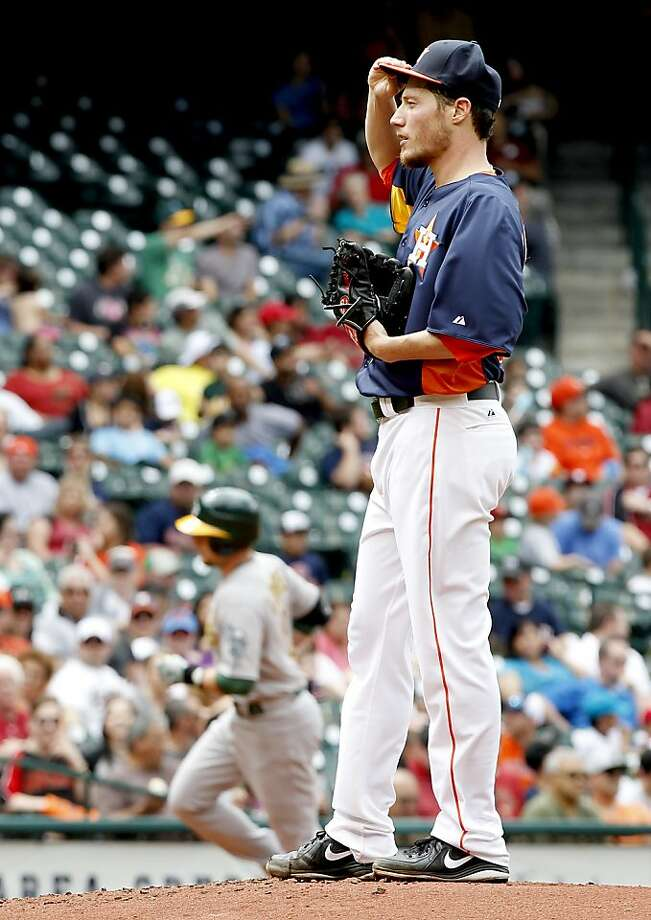 HOUSTON, TX - APRIL 07: Chris Young #25 of the Oakland Athletics rounds third base after hitting a two run home run against Lucas Harrell #64 of the Houston Astros in the third inning at Minute Maid Park on April 7, 2013 in Houston, Texas.  (Photo by Thomas B. Shea/Getty Images) Photo: Thomas B. Shea, Getty Images