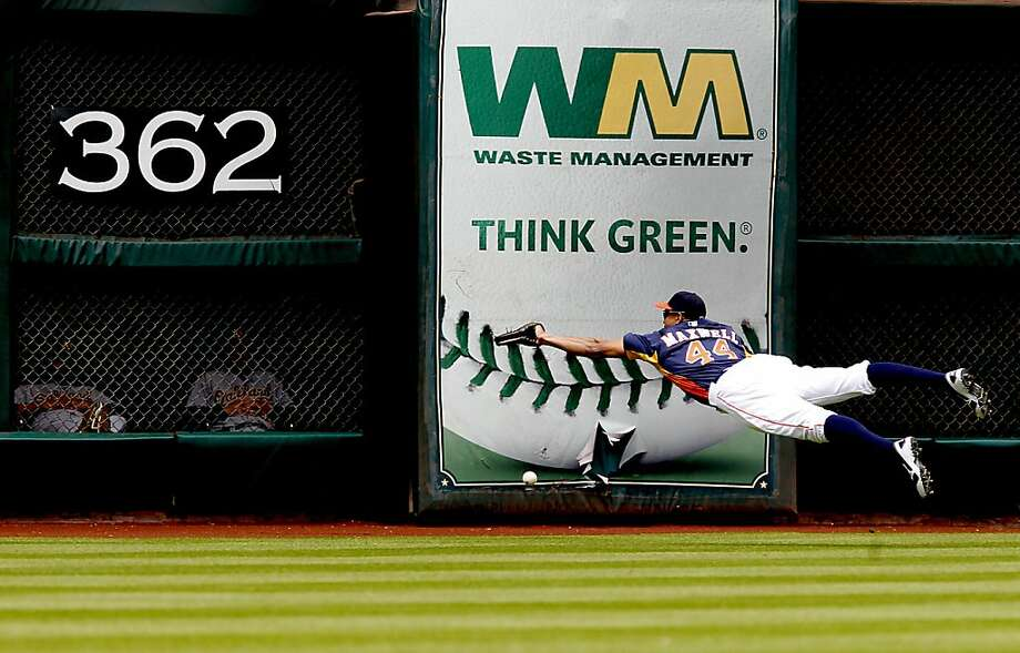 HOUSTON, TX - APRIL 07:  Justin Maxwell #44 of the Houston Astros dives for an Oakland Athletics hit in the first inning at Minute Maid Park on April 7, 2013 in Houston, Texas.  (Photo by Thomas B. Shea/Getty Images) Photo: Thomas B. Shea, Getty Images