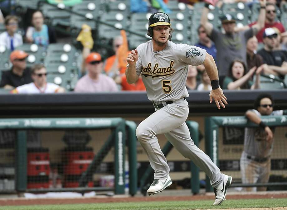 Oakland Athletics' John Jaso runs to home to score against the Houston Astros on a Brandon Moss single in the ninth inning of a baseball game Sunday, April 7, 2013, in Houston. Oakland won 9-3 to sweep the Astros in the three game series. (AP Photo/Pat Sullivan) Photo: Pat Sullivan, Associated Press