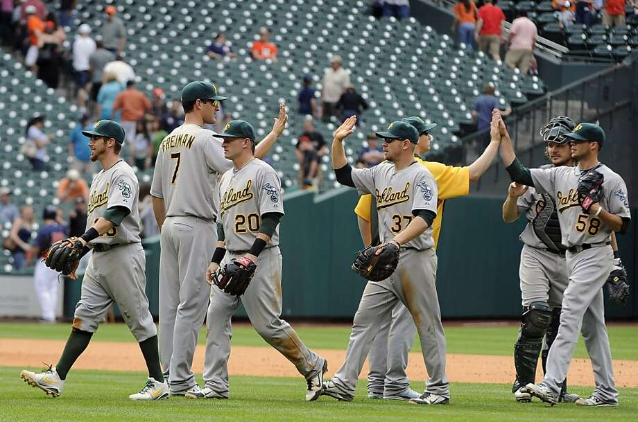 The Oakland Athletics celebrate their 9-3 win over the Houston Astros for a 3-game sweep in an MLB baseball game Sunday, April 7, 2013, in Houston. (AP Photo/Pat Sullivan) Photo: Pat Sullivan, Associated Press